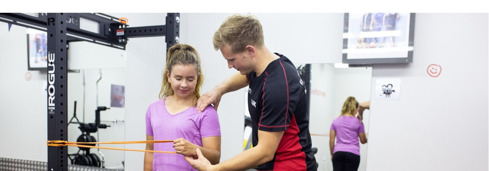 physiotherapist showing shoulder exercise for pain