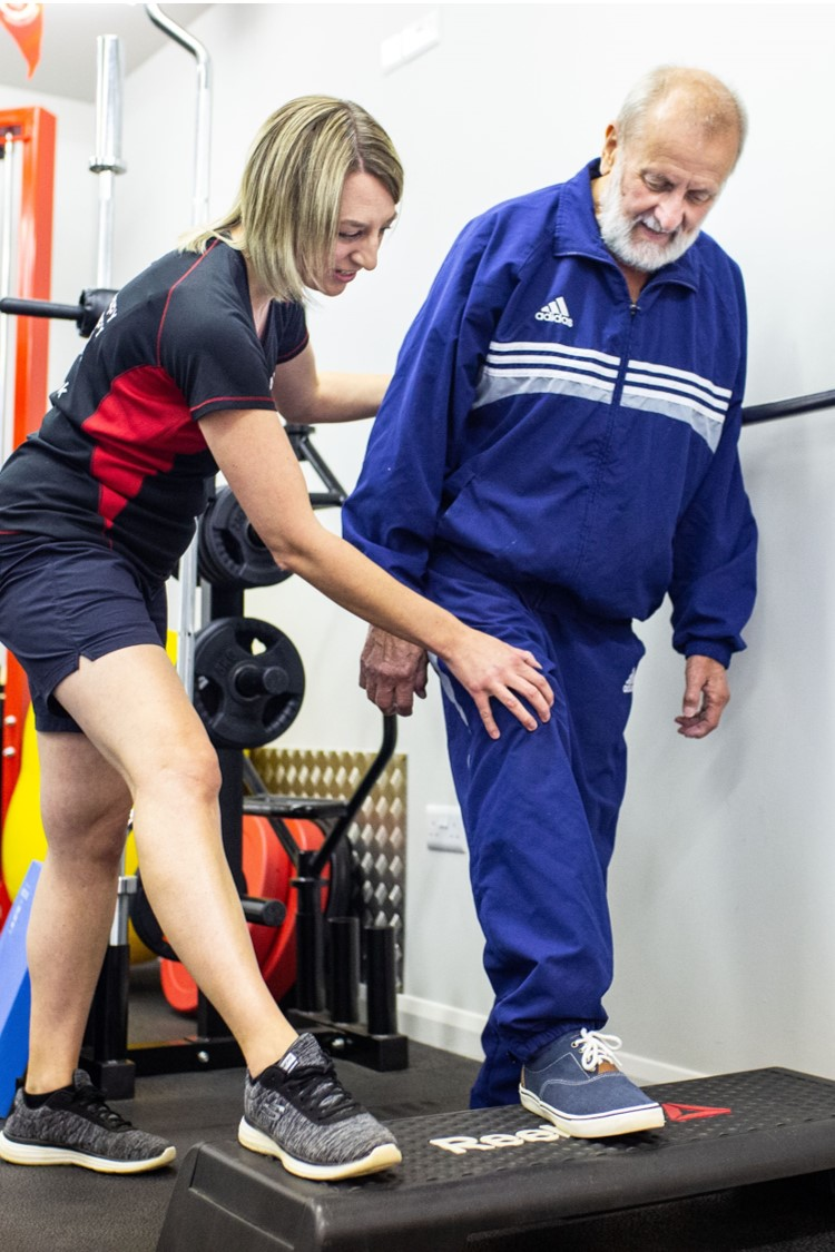 man receiving physiotherapy exercise