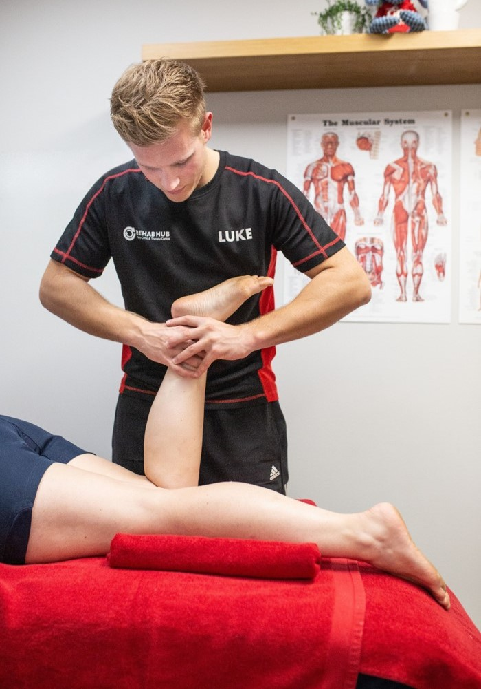 physiotherapist assesses ankle problem in biggleswade