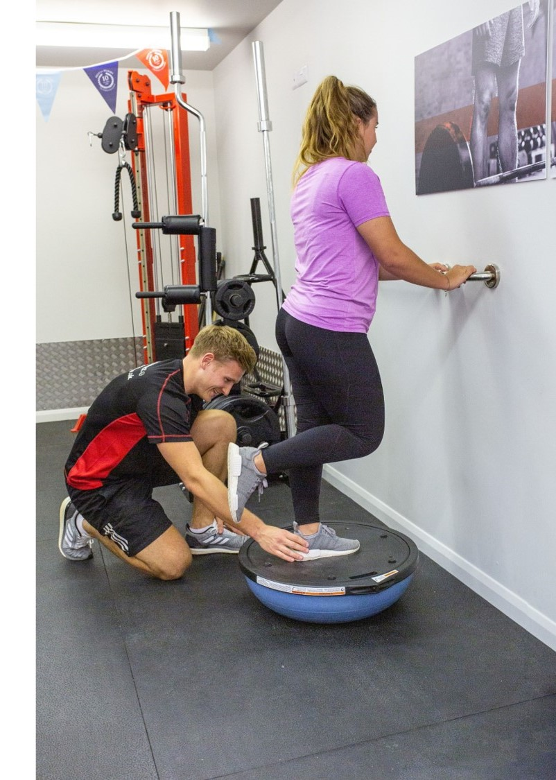 physiotherapist supervises ankle rehab exercise in biggleswade