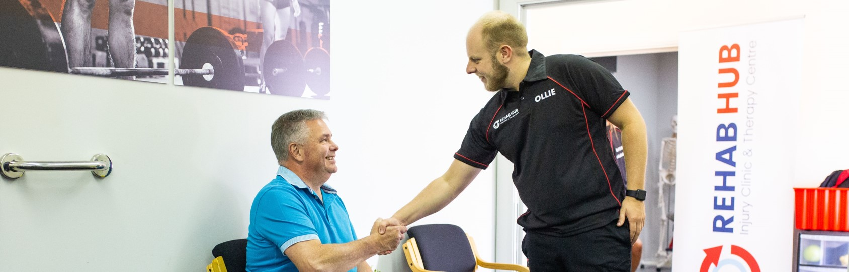 osteopath meets a new patient in clinic