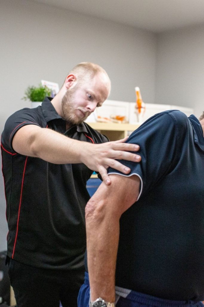 osteopath assesses spine movement in biggleswade