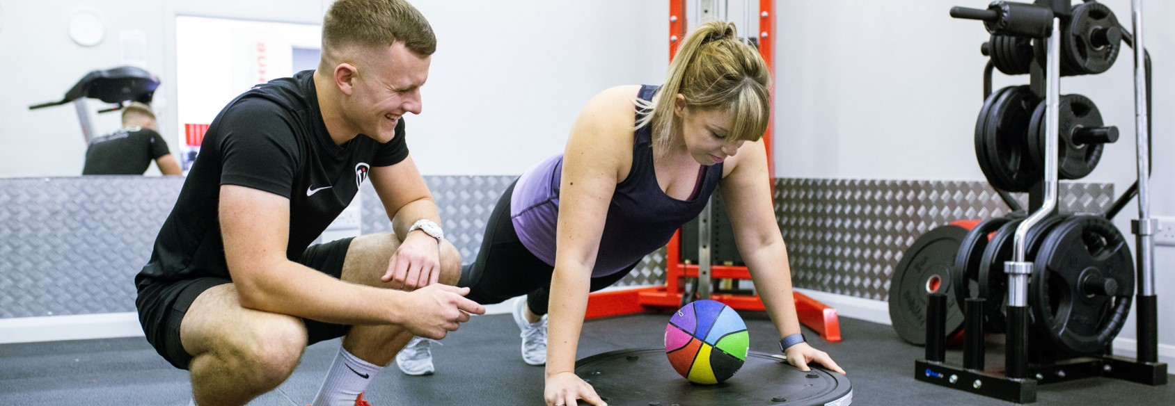 girl receives personal training exercise in biggleswade