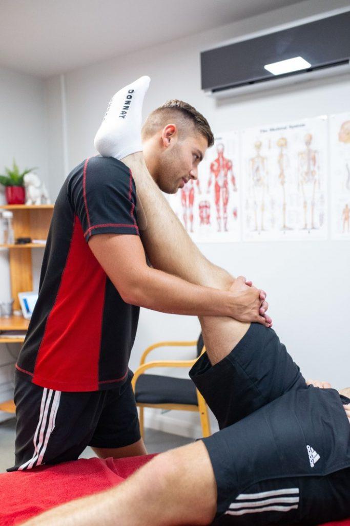 sports therapist treats hamstring strain in biggleswade